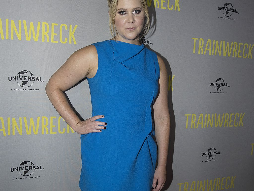 Amy Schumer shows off her VERY ample assets to promote Trainwreck in ...