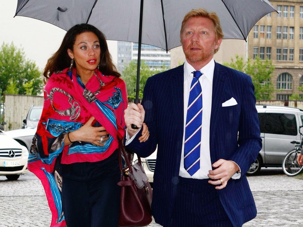 Lilly und Boris Becker unterm Regenschirm
