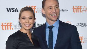 Elizabeth Olsen und Tom Hiddleston strahlen