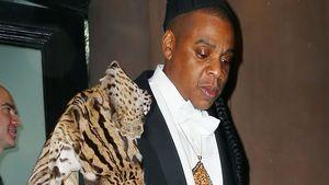 Jay Z mit einem Tier auf der Schulter