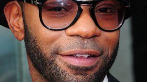 Nelsan Ellis mit Brille und Hut