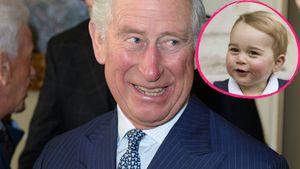 Prinz Charles lächelt Prinz George an