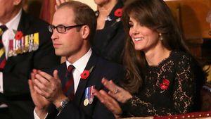 Prinz William und Herzogin Kate klatschen