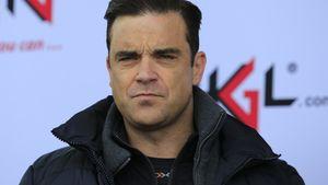 Robbie Williams mit zerknautschtem Gesicht