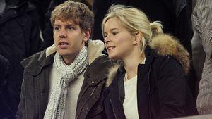 Sebastian Vettel und seine Freundin Hanna Prater auf der Tribüne