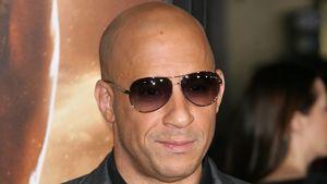 Vin Diesel lächelt bei einer Premiere