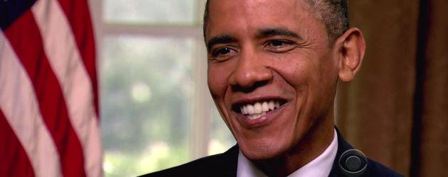 Barack Obama vor US-Flagge