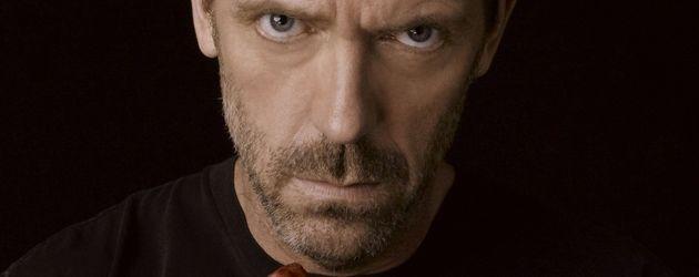 Hugh Laurie als House mit Herz in der Hand