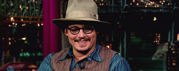 Johnny Depp mit Hut lachend
