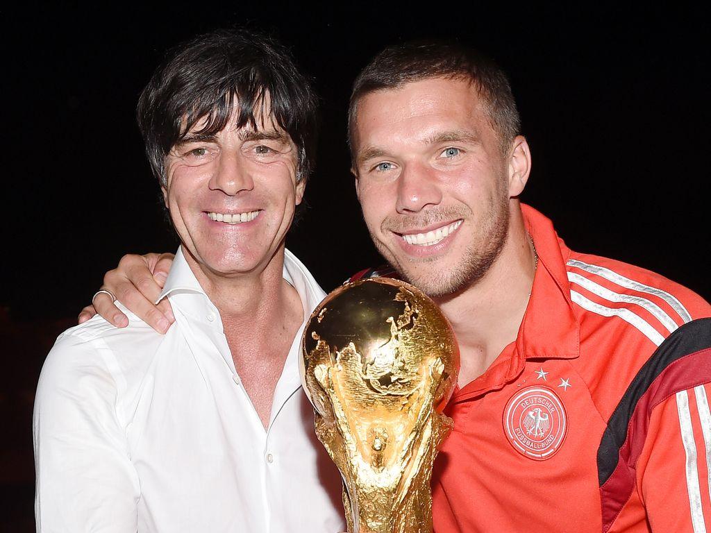 Joachim Löw (l.) und Lukas Podolski