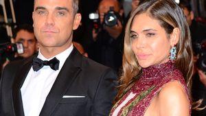 Ayda Field und Robbie Williams gucken grimmig