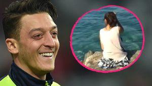 Mesut Özil und Unbekannte