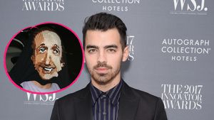 Joe Jonas versteckt sich unter seinem Pullover vor Paparazzi