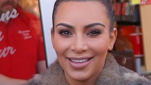 Kim Kardashian mit komischem Gesicht