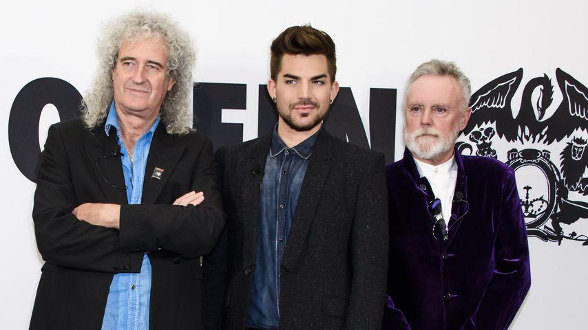 Brian May, Adam Lambert und Roger Taylor bei einem Event in Berlin 2014