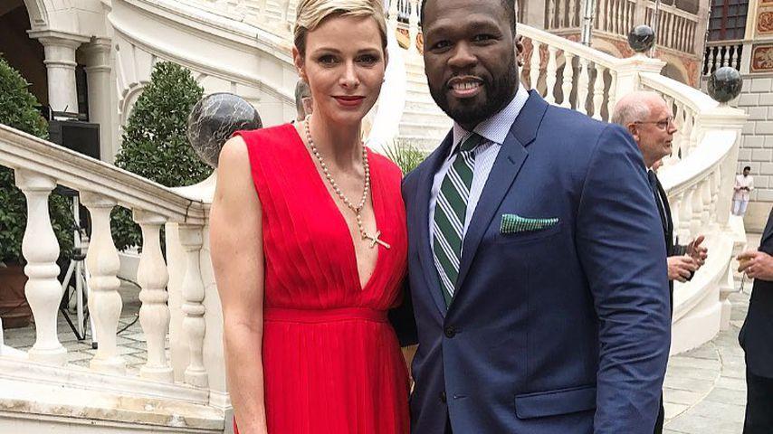 Fürstin Charlène von Monaco und 50 Cent bei einem Empfang
