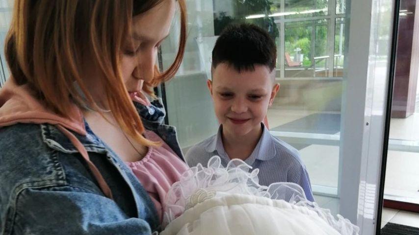 Darya und Ivan mit ihrem Baby, August 2020