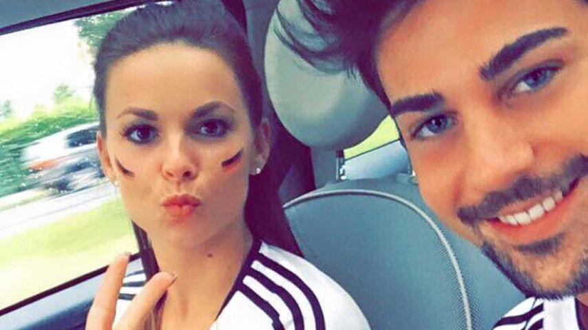 Denise Temlitz und Patrick Cuninka freuen sich über einen Sieg der deutschen Fußballnationalmannscha