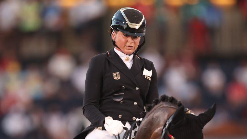 Dorothee Schneider und ihr Pferd Showtime FRH
