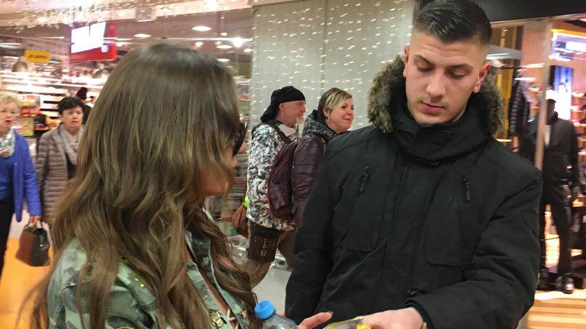 Gina-Lisa Lohfink und ihr Freund Emir am Frankfurter Flughafen