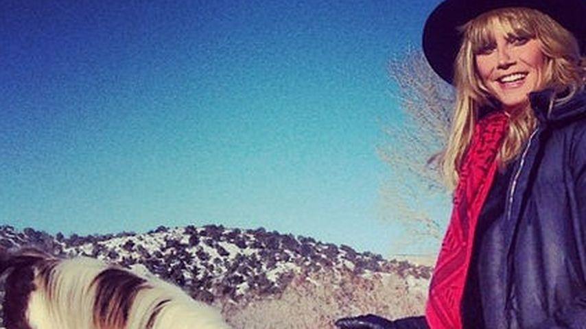 Wintermärchen im Schnee: Heidi Klum hoch zu Ross