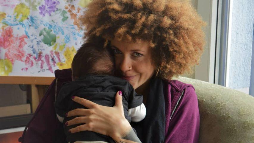Joy Lee Juana Abiola-Müller mit Söhnchen Lovis