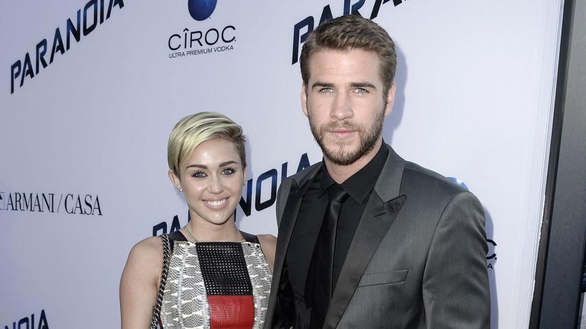 Miley Cyrus und Liam Hemsworth bei einer Filmpremiere