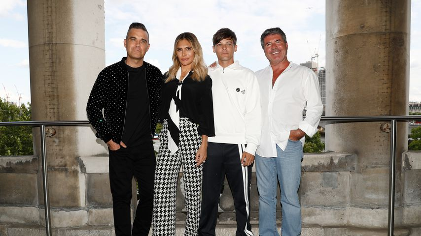 "Die ""The X-Factor""-Juroren Robbie Williams, Ayda Field Williams, Louis Tomlinson und Simon Cowell"