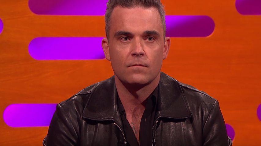 Robbie Williams schaut überrascht