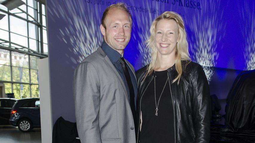 Robert Harting und Julia Fischer bei einer Autopräsentation in Berlin