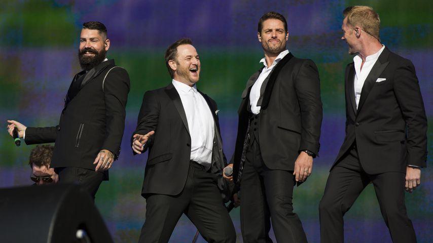 Shane Lynch, Mikey Graham, Keith Duffy und Ronan Keating von Boyzone bei einem Auftritt