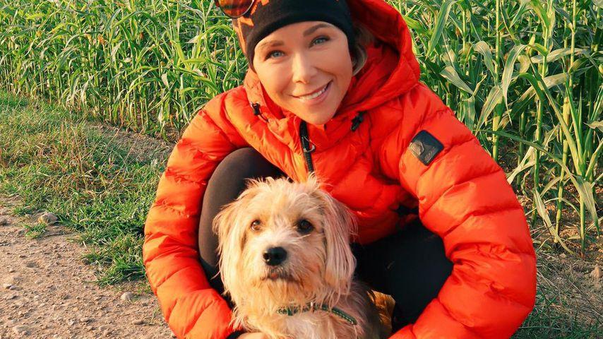 Tanja Szewczenko mit ihrem Hund Guido