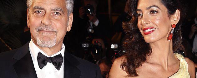 George Clooney und seine Frau Amal auf dem roten Teppich in Cannes 2016